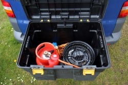 Inside of rear tow-bar-mounted storage box, showing portable BBQ.