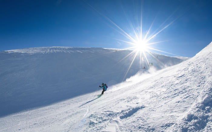 Skier in the Scottish mountains.